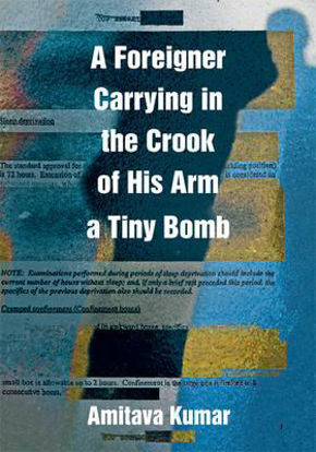 A Foreigner Carrying İn The Crook Of His Arm A Tiny Bomb resmi